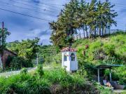 12 Urna & bus stop at Gararango pass